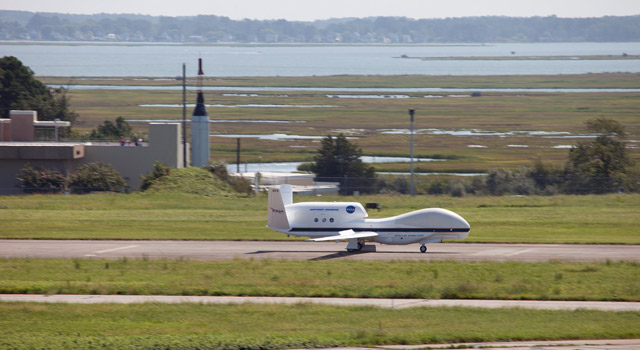 An unmanned NASA Global Hawk aircraft comes in for a landing at NASA's Wallops Flight Facility on Wallops Island, Va.