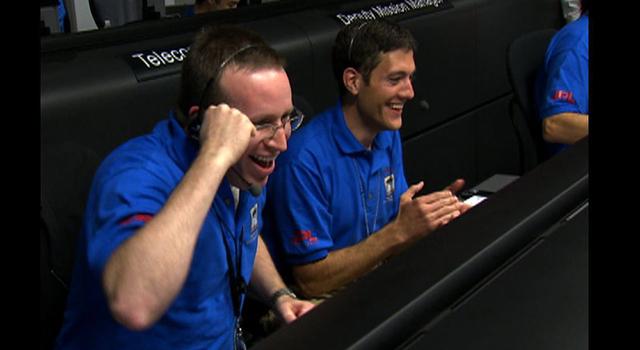 Team members celebrate Phoenix landing on Mars.