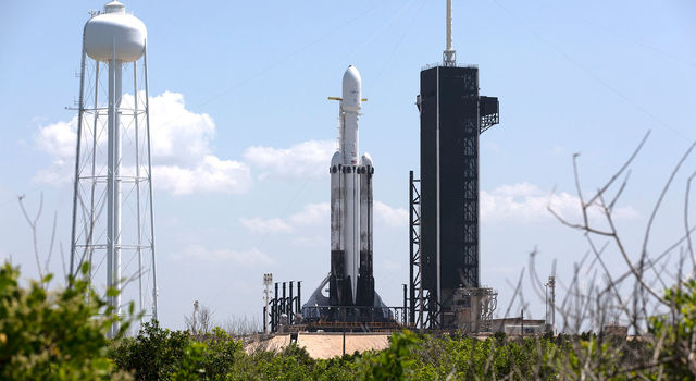 A SpaceX Falcon Heavy rocket is ready for launch on the pad at Launch Complex 39A at NASA's Kennedy Space Center in Florida
