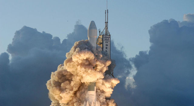 Dawn spacecraft rises from the smoke and fire on the launch pad