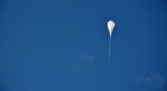 The test vehicle for NASA's Low-Density Supersonic Decelerator rides on a balloon to high altitudes above Hawaii.