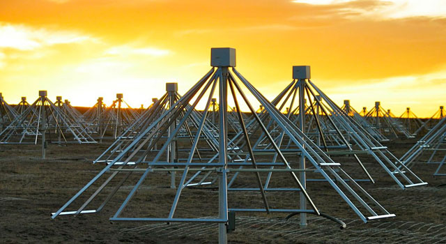 Multiple antennas of the LWA-1 station of the Long Wavelength Array in central New Mexico, photographed at sunset.