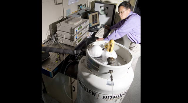 Researcher Fang Zhong analyzes ices like those found on Saturn's moon Titan in JPL's Ice Physical Properties Laboratory.