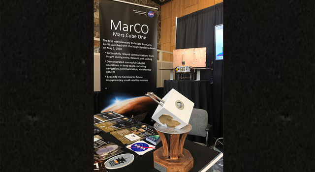 The 2019 Small Satellite Mission of the Year Award sitting at a MarCO exhibit space at the Small Satellite Conference in Logan, Utah.