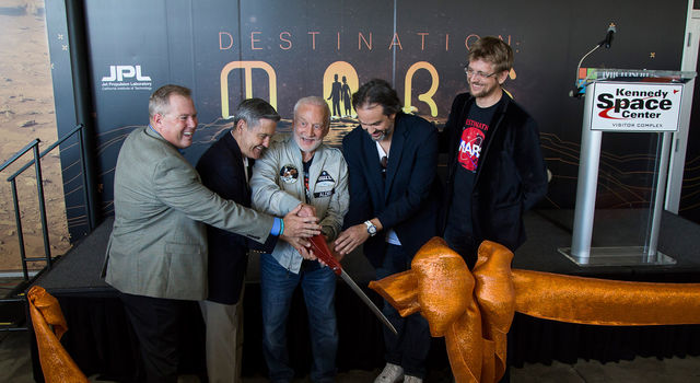 A ceremonial ribbon is cut for the opening of new 'Destination: Mars' experience at the KSC visitor complex in Florida.