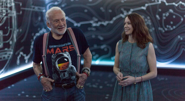 Apollo 11 astronaut Buzz Aldrin, left, and Erisa Hines of NASA's Jet Propulsion Laboratory in Pasadena, California.
