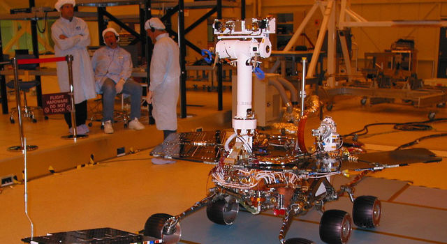 Mars Exploration Rover 2 stands next to the flight spare of the Pathfinder mission's Sojourner rover
