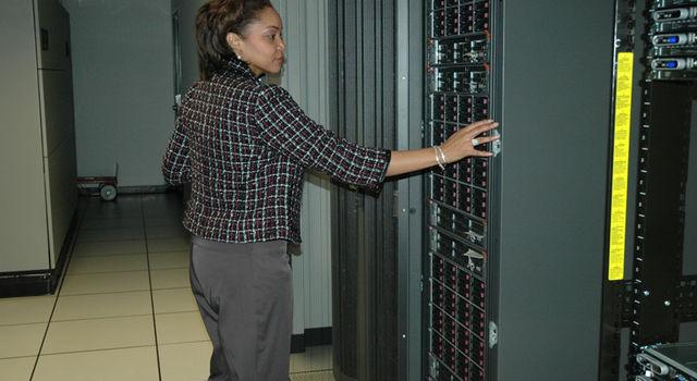 Magalene Powell-Meeks inspects servers