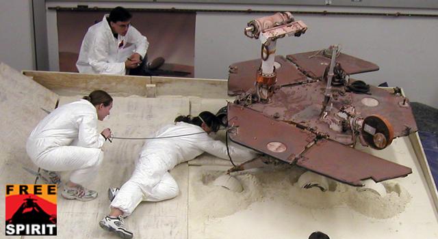 Mars Exploration Rover team members prepare a testing setup for the Spirit rover.