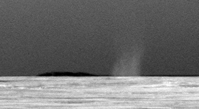 Opportunity's first view of a dust devil on Mars