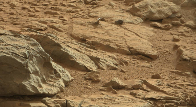 A shiny-looking Martian rock is visible in this image