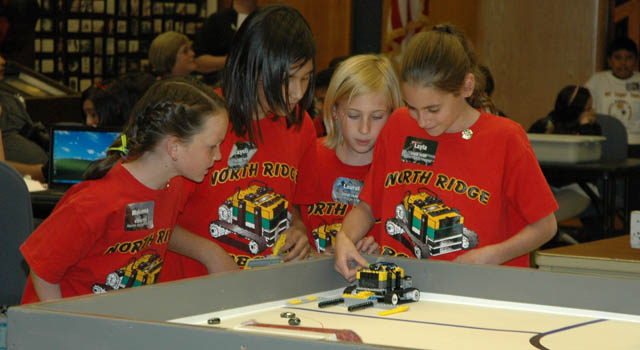 students from North Ridge Magnet School ready their robot.
