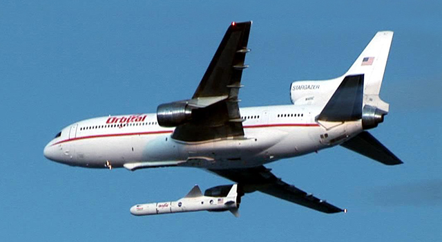 The Orbital Science Corporation's 'Stargazer' plane is shown releasing its Pegasus rocket.