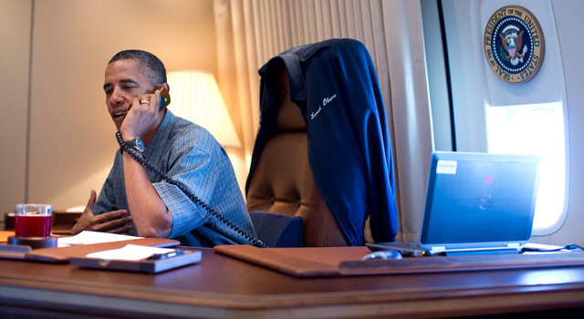 President Barack Obama talks on the phone with NASA's Curiosity Mars rover team