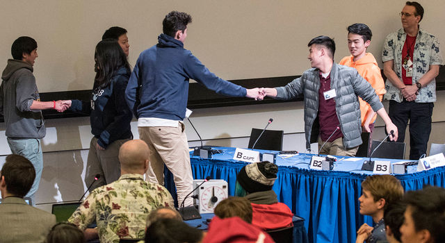 Members of the Santa Monica High School and Arcadia High School Ocean Sciences Bowl teams shake hands