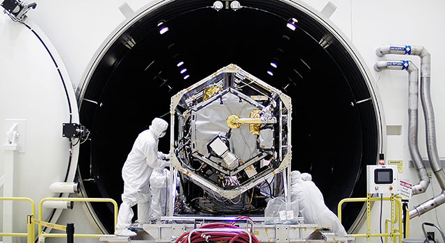 NASA's Orbiting Carbon Observatory (OCO)-2 spacecraft is moved into a thermal vacuum chamber