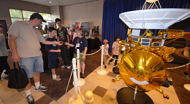 Visitors learn about Cassini, NASA's mission to explore Saturn and its moons