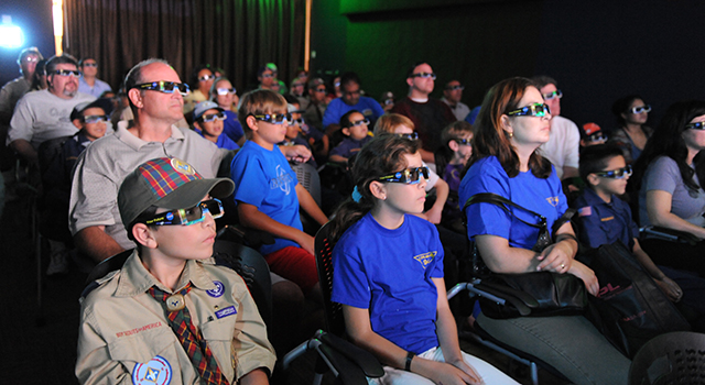 Spectators learn about Earth and climate change in 3-D.