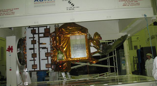spacecraft being loaded into container