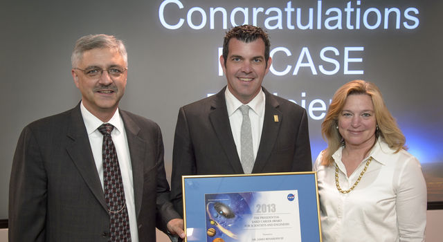 James Benardini, with JPL planetary protection, poses with NASA chief scientist Ellen Stofan, right, and Acting Associate Administrator for NASA's Science Mission Directorate Geoff Yoder, left