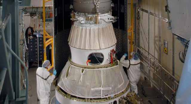 first half of the fairing is installed around the Phoenix spacecraft