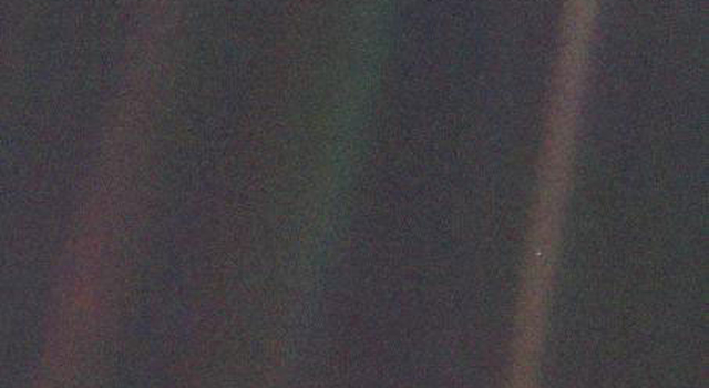 Earth,  seen from Voyager 1 at a distance of 4 billion miles