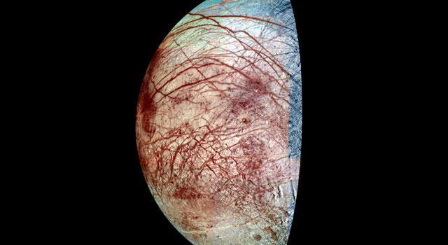 Europa, a moon of Jupiter, appears as a thick crescent in this enhanced-color image from NASA's Galileo spacecraft, which was orbited Jupiter from 1995 to 2003.