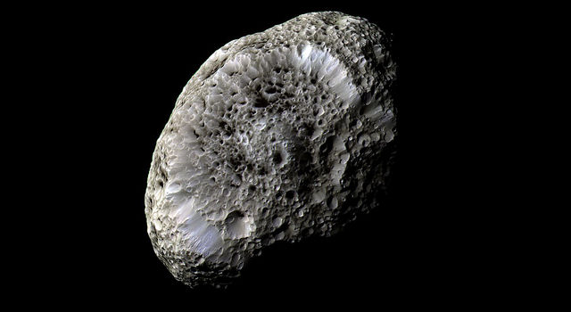 false-color view of Hyperion was obtained during Cassini's closest flyby of Saturn's odd, tumbling moon on Sept. 26, 2005