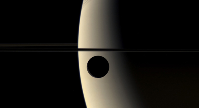 shadow of Rhea in front of Saturn