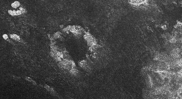 impact crater or a cryovolcanic caldera