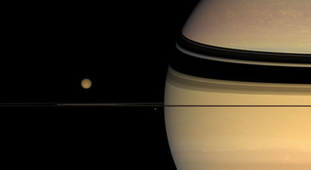 Four moons huddle near Saturn's multi-hued disk