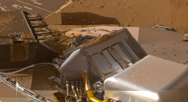 Instruments on NASA's Phoenix Mars Lander included the Thermal and Evolved Gas Analyzer, right, which analyzed the atmosphere, as well as soil samples.