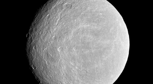 The cratered plains of Saturn's moon Rhea are visible in this image obtained by NASA's Cassini spacecraft on Nov. 21, 2009.