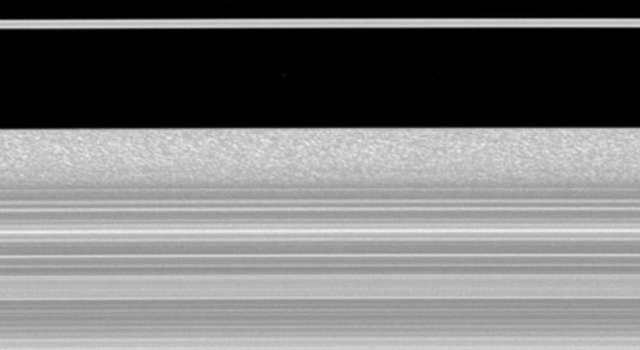 Keeping a close watch on the outer portion of Saturn's B ring, Cassini records the complex inward and outward movement of the edge of the ring.
