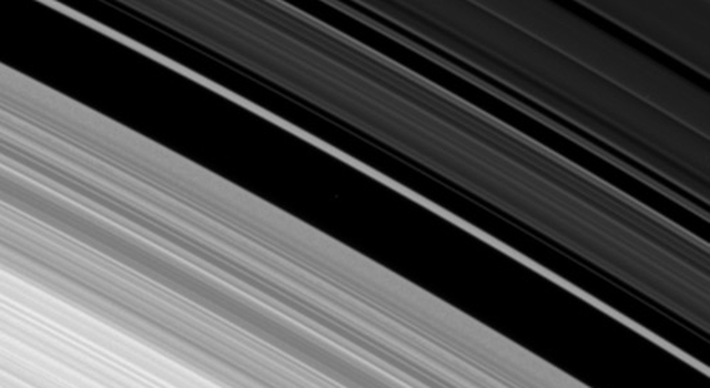Images obtained by Cassini of the outer edge of Saturn's B ring reveals the combined effects of a tugging moon and oscillations that can naturally occur.