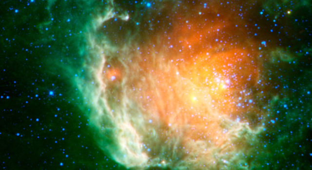 This image shows a cosmic rosebud blossoming with new stars.