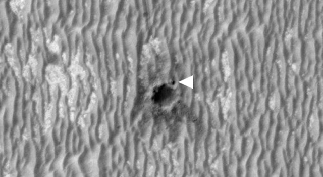 This image shows NASA's Mars Exploration Rover Opportunity perched on the edge of 'Concepción' crater in Meridiani Planum, Mars.