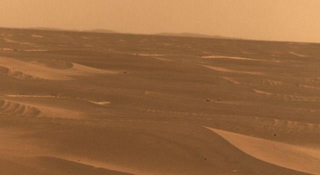 NASA's Mars Exploration Rover used its panoramic camera to record this view of the rim of a crater about 65 kilometers (40 miles) in the distance, on the southwestern horizon.