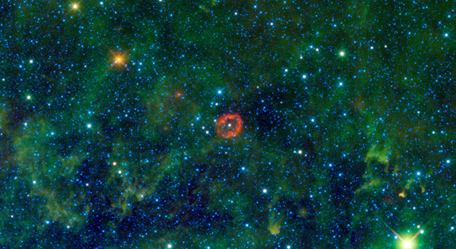 The red object in this infrared image is a sphere of stellar innards, blown out from a humongous star.