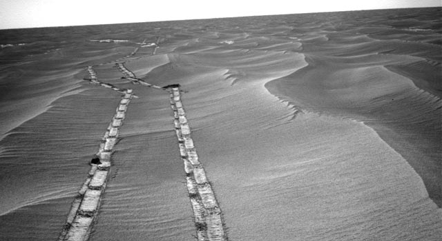 NASA's Mars Exploration Rover Opportunity used its navigation camera for this northward view of tracks the rover left on a drive from one energy-favorable position on the northern end of a sand ripple to another.