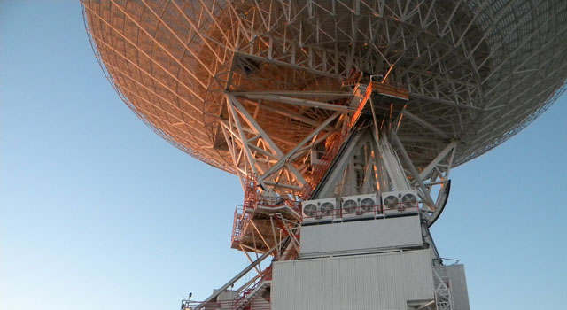 Workers at NASA's Deep Space Network communications site