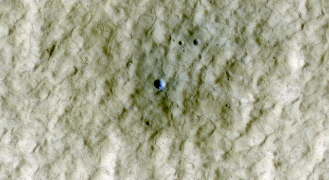 Exposed ice in a fresh crater on Mars