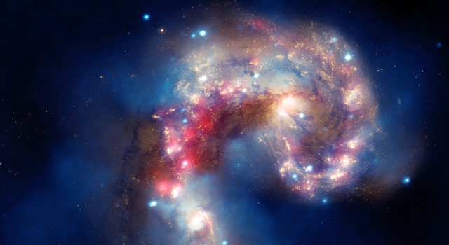 A new image of two tangled galaxies has been released by NASA's Great Observatories