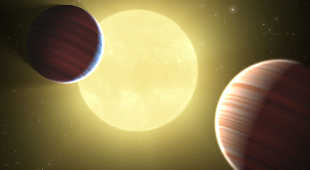 This artist's concept illustrates the two Saturn-sized planets discovered by NASA's Kepler mission.