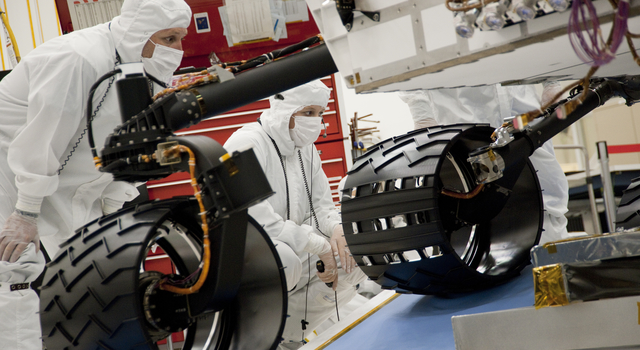 Test operators monitor how NASA's Mars rover Curiosity handles driving over a ramp during a test on Sept. 10, 2010,