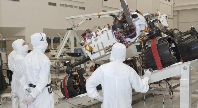 NASA's next Mars rover, Curiosity, stretches its robotic arm upward during Sept. 3, 2010, tests on a tilt table in a clean room at NASA's Jet Propulsion Labotatory, Pasadena, Calif.