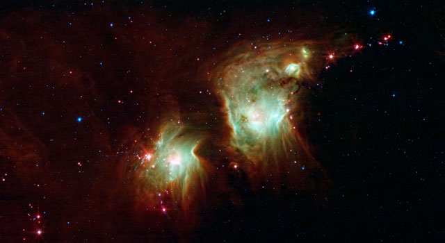Best known as Messier 78, the two round greenish nebulae are actually cavities carved out of the surrounding dark dust clouds.