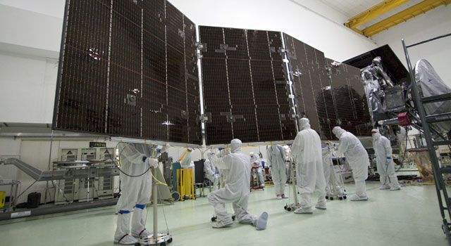 Technicians at Astrotech's payload processing facility in Titusville
