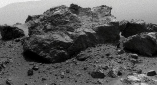 'Ridout' Rock on Rim of Odyssey Crater