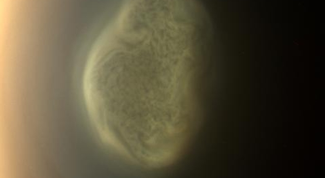 Titan's Colorful South Polar Vortex